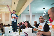 Eddie Warshawsky, 11, stands on his chair during the live auction to place his bid during the Milpitas Chamber of Commerce Crab Feed at Napredak Hall in San Jose, California, on March 6, 2015. (Stan Olszewski/SOSKIphoto)