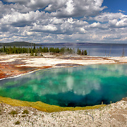 With a depth 53 feet (and a temp of 172°F), Abyss Pool is the deepest pool known in Yellowstone. The dark blue/green-colored hot spring is one of the most colorful in the West Thumb Geyser Basin, situated with picturesque Yellowstone Lake as a backdrop.