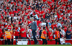 Arsenal manager Arsene Wenger celebrates his sides second goal of the match from the touchline