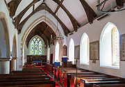 Church of Saint Peter, Holton, Suffolk, England, UK interior nave, chancel arch altar, east window c 1899 by Kempe
