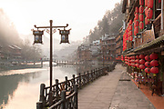 View of the architecture and houses in a traditional Chinese old town along a river, Fenghuang, Hunan Province, China