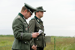 Members of the Northern World War Two Association portraying 1st company 1st Battalion GrossDeutschland Division German Army Major and Unteroffizier take roll call in the Axis living history camp..Scarborough Castle Saturday 29th May 2010 .Images © Paul David Drabble.