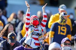 Oct 31, 2020; Morgantown, West Virginia, USA; A West Virginia Mountaineers fan cheers during the second quarter against the Kansas State Wildcats at Mountaineer Field at Milan Puskar Stadium. Mandatory Credit: Ben Queen-USA TODAY Sports