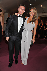 NICK CANDY and HOLLY VALANCE at the GQ Men of The Year Awards 2012 held at The Royal Opera House, London on 4th September 2012.