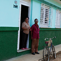 Central America, Cuba, Remedios. A couple standing in their doorway in Remedios.