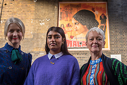 © Licensed to London News Pictures. 18/10/2018. LONDON, UK.  (L to R) Justine Simons, Deputy Mayor for Culture and Creative Industries, artist Justine Sehra and Tate Director Maria Balshaw in front of a newly unveiled artwork in Brick Lane. The artwork features human rights activist Mala Sen and is one of 20 newly-commissioned artworks, designed by the London Tate Collective team, Tate's group for 16 to 25 year old artists, which will appear in public spaces across the city marking the centenary of women's suffrage.  Called LDN WMN, the artworks celebrate women who have played a crucial role in London's history, but have been largely overlooked.  Photo credit: Stephen Chung/LNP