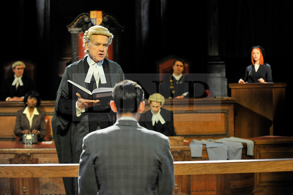 "© Licensed to London News Pictures. 20/10/2017. London, UK. David Yelland as Sir Wilfrid Robarts addresses Jack McMullen as Leonard Vole, the accused. Photocall for ""Witness for the Prosecution"", by Agatha Christie, directed by Lucy Bailey, at London County Hall.  The play opens 23 October. Photo credit : Stephen Chung/LNP"