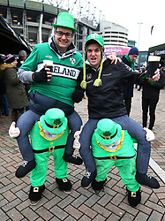 Ireland fans pose for a picture prior to the NatWest 6 Nations match at Twickenham Stadium, London.