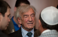 Nobel Peace Prize winner Elie Wiesel chats with members of the audience at Congregation Torat El in Ocean where he was the guest speaker. This was at a reception there after he spoke.  // Russ DeSantis/For NJJN - 9/18/11