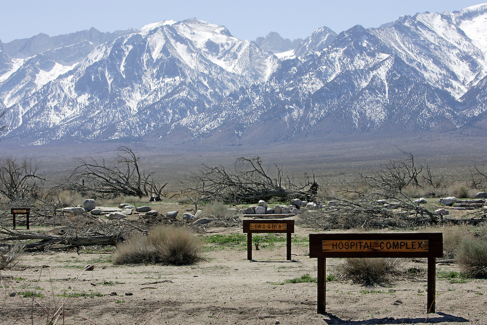 INDEPENDENCE, CA, March 19, 2008: Signs mark the site of buildings that once stood at Manzanar, one of ten remote War Relocation Centers in the United States where 11,000 Japanese were sent beginning in early 1942 during World War II. Not trusting those with cultural ties to Japan who had bombed Pearl Harbor, the U.S. Government enclosed a  one square mile, remote area in the Eastern Sierra mountains with barbed wire and erected a mini city complete with churches, barracks, mess halls, hospitals and even baseball fields. A cemetery and graves still adorn the property which is now a National Historic Site.