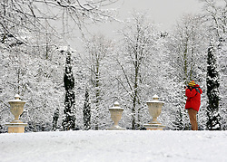 © Licensed to London News Pictures. 10/02/2012, London, UK. A man photographs the snow.  People enjoy the snow in the grounds of Chiswick House in West London today 10 February 2012. Chiswick House, undergoing restoration,  is the first and one of the finest examples of neo-Palladian design in England.  Inspired by the architecture of ancient Rome and 16th Century Italy, the third Earl of Burlington built the house as a homage to Renaissance architect Palladio.The cold weather across the UK is set to continue over the weekend.  Photo credit : Stephen Simpson/LNP