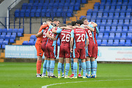 Scunthorpe United squad huddle together before kick off during the EFL Sky Bet League 2 match between Tranmere Rovers and Scunthorpe United at Prenton Park, Birkenhead, England on 3 October 2020.