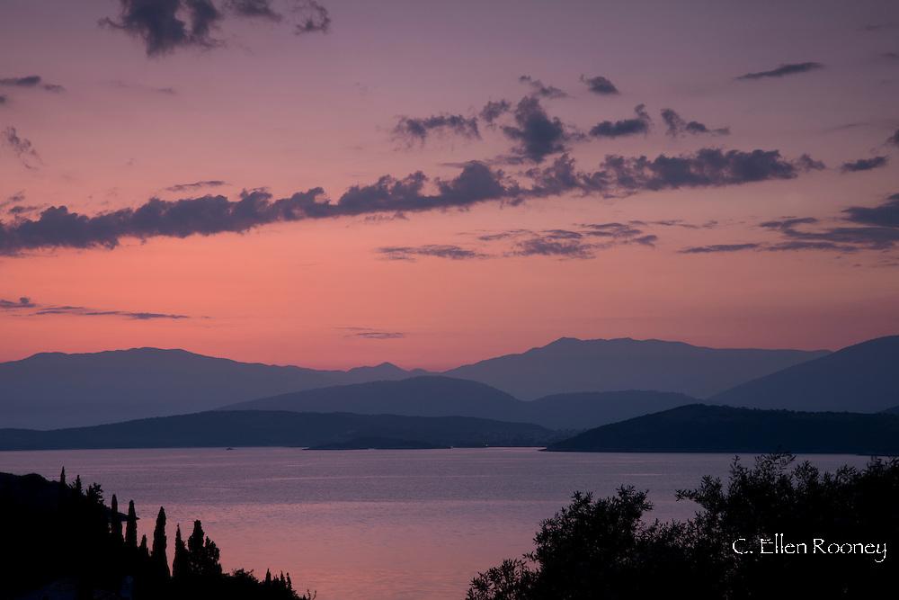 Sunrise looking from the northeast coast of Corfu to Albania over the Ionian Sea.  Corfu, The Ionian Islands, Greece
