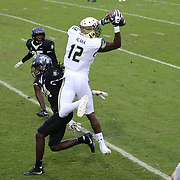 South Florida Bulls wide receiver Temi Alaka (12) catches the ball for a touchdown during a NCAA football game between the University of South Florida Bulls and the UCF Knights at Spectrum Stadium on Friday, November 24, 2017 in Orlando, Florida. (Alex Menendez via AP)