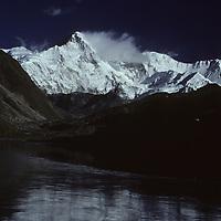 NEPAL, HIMALAYA, Cho Oyu, world's 8th highest peak, reflected in lake, Gokyo Valley, Khumbu Region