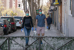 A couple in the center of the city after the Spanish Government decree the State of Alarm in the country and the confinement of the population during the health crisis due to the Covid-19 virus pandemic - Coronaviruss. March 15,2020. (ALTERPHOTOS/Jesus Anton JAM)