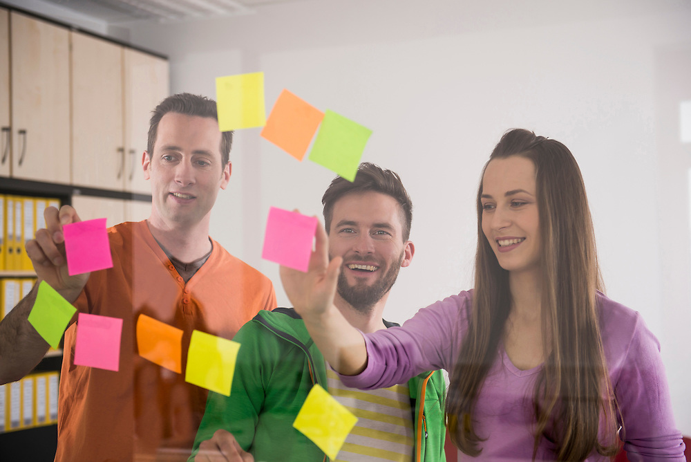 Young colleagues thinking planning using post-its