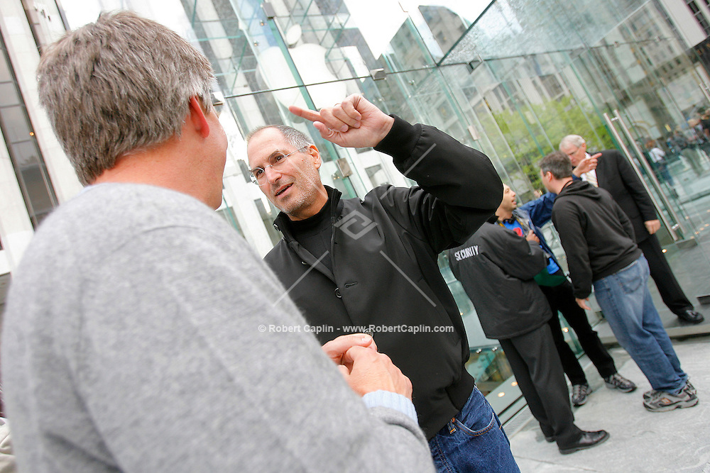 Steve Jobs, Apple Computer, Inc. chief executive officer, right, and Ronald Johnson, senior vice president of retail for Apple Computer, Inc., stand outside the new Apple Store in New York moments prior to the grand opening on Friday, May 19, 2006. Apple Computer Inc., maker of the iPod music player, opened a 24-hour subterranean store in New York City, marking five years in retailing with an outlet built beneath a 32-foot glass cube.