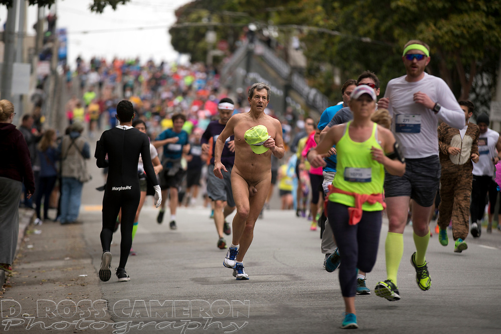 An unidentified naked man coasts down the backside of the Hayes Street hill, during the 104th running of the Bay to Breakers 12k, Sunday, May 17, 2015 in San Francisco. Tens of thousands of runners, some clad in costume and some in nothing at all, populated the 7.42-mile route. (D. Ross Cameron/Bay Area News Group)