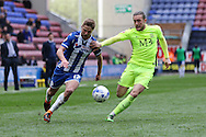 Michael Jacobs of Wigan Athletic (l) and Ben Coker of Southend United challenge for the ball. Skybet football league one match , Wigan Athletic v Southend Utd at the DW Stadium in Wigan, Lancs on Saturday 23rd April 2016.<br /> pic by Chris Stading, Andrew Orchard sports photography.