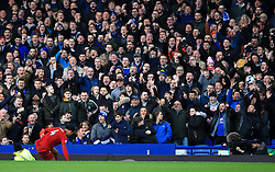 Liverpool's Virgil van Dijk (bottom left) in front of the Everton fans during the Premier League match at Goodison Park, Liverpool.
