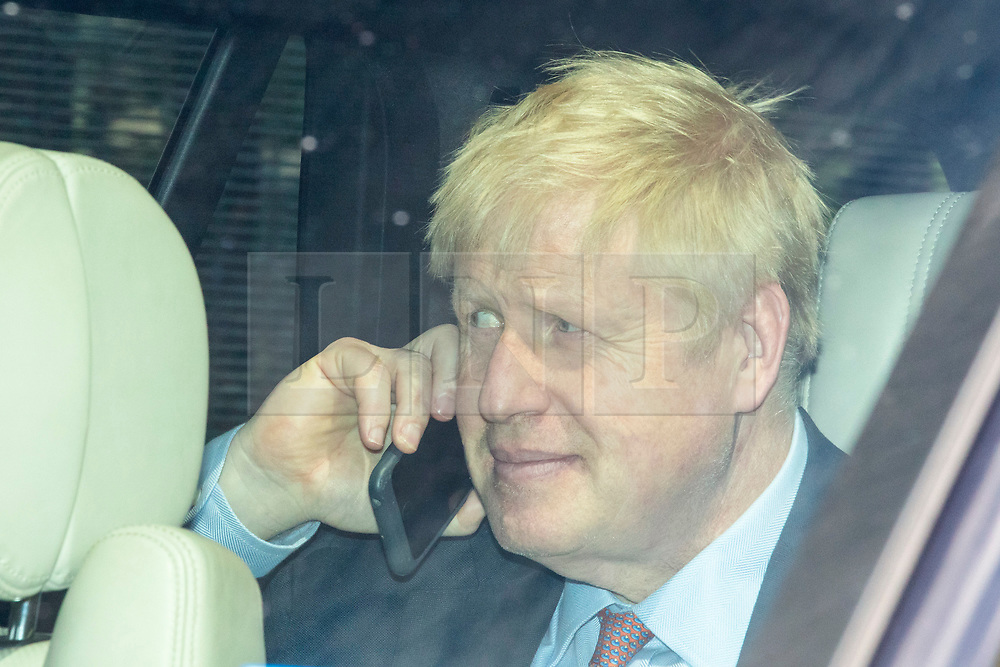 © Licensed to London News Pictures. 17/06/2019. London, UK. Boris Johnson leaves Parliament by car after other candidates for the leadership of the Conservative party appeared at a hustings before lobby journalists. A second round of voting on the new leader will take place tomorrow. Photo credit: Rob Pinney/LNP