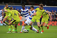 Queens Park Rangers midfielder Massimo Luongo (21) battles for possession with Rotherham United midfielder Lee Frecklington (8) during the EFL Sky Bet Championship match between Queens Park Rangers and Rotherham United at the Loftus Road Stadium, London, England on 18 March 2017. Photo by Matthew Redman.
