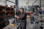 A worker at the Somcelik Shelf factory in Kayseri, Turkey. The company produces shelves and storage equipment, around 30% of which is exported overseas.