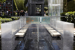 © licensed to London News Pictures. LONDON, UK  23/05/2011. A water feature and table with a built in aquarium form part of the B&Q garden at the 2011 RHS Chelsea Flower Show. The show held each year in the grounds of the Royal Chelsea Hospital and organised by the Royal Horticultural society opens to the general public tomorrow and is already sold out. Please see special instructions for usage rates. Photo credit should read CLIFF HIDE/LNP