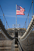 American flag on top of the Brooklyn Bridge in New York City USA