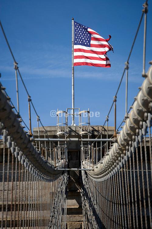 American flag on top of the Brooklyn Bridge in New York City USA