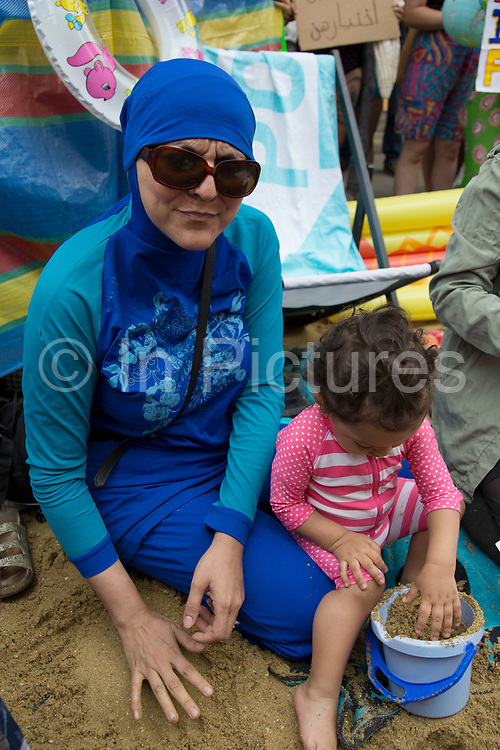 """'Wear what you want' protest at the French embassy against the burkini ban for Muslim women onFrance's beaches on 25th August 2016 in London, United Kingdom. Activists called on fellow supporters to descend on Knightsbridge saying """"Come along to the French embassy and wear what you want - burkinis, bikinis, anything goes. Bring beach gear: beach umbrellas, towels, bat and ball, boules... Join us at the French embassy to show solidarity with French Muslim women and to call for the repeal of this oppressive law by the French Government."""" (photo by Mike Kemp/In Pictures via Getty Images)"""