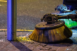 "© Licensed to London News Pictures . 24/12/2016 . Manchester , UK . A street cleaner brushes away vomit from the pavement . Revellers out in Manchester City Centre overnight during 2016's second "" Mad Friday "" , named for historically being one of the busiest nights of the year for the emergency services in the UK . Photo credit : Joel Goodman/LNP"
