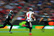 A slow shutter speed shot of Houston Texan's quarterback, Deshaun Watson (4) runs with the ball during the NFL game between Houston Texans and Jacksonville Jaguars at Wembley Stadium in London, United Kingdom. 03 November 2019