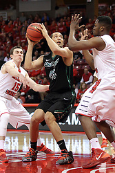 18 March 2015:   Kenneth Lowe is challenged on a shot from the lane by John Jones and Justin McCloud during an NIT men's basketball game between the Green Bay Phoenix and the Illinois State Redbirds at Redbird Arena in Normal Illinois
