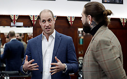 The Duke of Cambridge speaks to Tom Chapman founder of the charity as he meets members of the Lion Barbers Collective, who are raising awareness of suicide prevention through a programme called BarbersTalk, during a visit to Pall Mall Barbers in Paddington, west London.