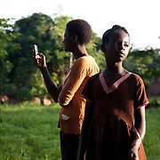 Young girls using their mobile phone in rural Makurdi in Benue state. My QandA is mobile phone text service run by EVA where young people can ask questions about sexual health anonymously. Benue state has got one of the highest HIV prevalence in Nigeria and EVA aim to target vulnerable children who would otherwise miss out of being tested for HIV and therefor not know their HIV statues.  Education As a Vaccine Against Aids (EVA) in Nigeria.Education As a Vaccine Against Aids (EVA) in Nigeria.Against Aids (EVA) in Nigeria.