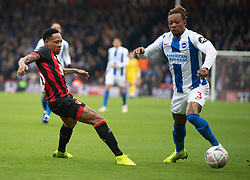 AFC Bournemouth's Nathaniel Clyne (left) and Brighton's Gaetan Bong battle for the ball