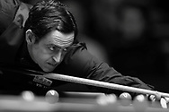 Ronnie O'Sullivan of England in action during his match against Tian Pengfei . Note Image has been converted into black & white. Betvictor Welsh Open snooker 2016, day 2 at the Motorpoint Arena in Cardiff, South Wales on Tuesday 16th Feb 2016.  <br /> pic by Andrew Orchard, Andrew Orchard sports photography.
