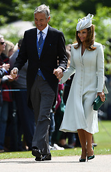 David and Jane Matthews, parents of the groom, arrive ahead of the wedding of Pippa Middleton to her millionaire groom James Matthews, dubbed the society wedding of the year at, St Mark's church in Englefield, Berkshire.