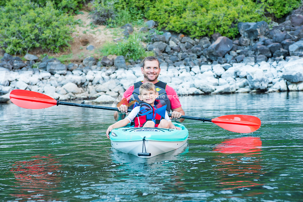 Father and son kayaking Blue Heart Springs on the Snake River Hagerman, Idaho. MR