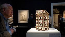 © Licensed to London News Pictures. 02/10/2015. London, UK. A visitor views a magnificent Ottoman Tortoiseshell and Pearl Box, circa 1640 (est £70k - 100k) at the preview of Indian and Islamic Art Week at Sotheby's which runs from 2 to 7 October.   Photo credit : Stephen Chung/LNP