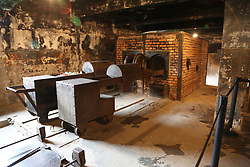 Interior of the crematorium of Auschwitz I, at the Auschwitz-Birkenau Nazi concentration camps in Auschwitz, Poland on September 3, 2017. Auschwitz concentration camp was a network of German Nazi concentration camps and extermination camps built and operated by the Third Reich in Polish areas annexed by Nazi Germany during WWII. It consisted of Auschwitz I (the original camp), Auschwitz II–Birkenau (a combination concentration/extermination camp), Auschwitz II–Monowitz (a labor camp to staff an IG Farben factory), and 45 satellite camps. In September 1941, Auschwitz II–Birkenau went on to become a major site of the Nazi Final Solution to the Jewish Question. From early 1942 until late 1944, transport trains delivered Jews to the camp's gas chambers from all over German-occupied Europe, where they were killed en masse with the pesticide Zyklon B. An estimated 1.3 million people were sent to the camp, of whom at least 1.1million died. Around 90 percent of those killed were Jewish; approximately 1 in 6 Jews killed in the Holocaust died at the camp. Others deported to Auschwitz included 150,000 Poles, 23,000 Romani and Sinti, 15,000 Soviet prisoners of war, 400 Jehovah's Witnesses, and tens of thousands of others of diverse nationalities, including an unknown number of homosexuals. Many of those not killed in the gas chambers died of starvation, forced labor, infectious diseases, individual executions, and medical experiments. In 1947, Poland founded a museum on the site of Auschwitz I and II, and in 1979, it was named a UNESCO World Heritage Site. Photo by Somer/ABACAPRESS.COM