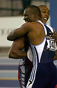 Shawn Crawford is congratulated by John Capel after they finished first and second in the 60 meters in the USA Track & Field Championships at Reggie Lewis Center at Roxbury Community College on Saturday, Feb. 28, 2004 in Roxbury Crossing, Mass.