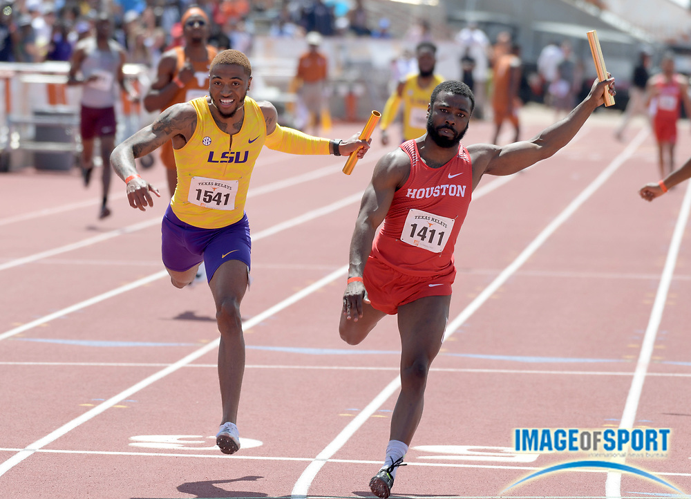 Mar 31, 2018; Austin, TX, USA; Cameron Burrell of Houston (1411) defeats Jaron Flournoy of LSU (1541) on the anchor of the 4 x 100m relay, 38.915 to 38.919, during the 91st Clyde Littlefield Texas Relays at Mike A. Myers Stadium.