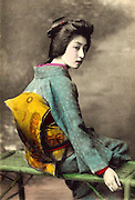 Memories of a geisha: Stunning images reveal the delicate beauty of the woman who enchanted Tokyo 100 years ago<br /> <br /> <br /> The beauty of one of Tokyo's most popular geisha has been preserved in a series of stunning postcards taken more than a century ago. <br /> The collection of images shows Hawaryu, who worked in the Japanese capital at the beginning of the 20th century, posing in a variety of elaborate kimono with her hair pinned in traditional style. <br /> Her porcelain skin and doll-like features have captured the imagination of internet users who have shared the pictures hundreds of times since they were posted. <br /> They were unearthed by an American photographer who lives and works in Japan and posted on hisFlickr account under the name Okinawa Soba. <br /> He said the selection were taken in 1910, only a few years before the number of geisha working in the country reached its peak.<br /> It is not known how old Hawaryu is in the series of pictures but her hairstyle suggests she was an apprentice geisha - or maiko - and therefore was probably under 20 years old. <br /> Geisha as a profession emerged in the 18th century and rather than courtesans, women would entertain act as hostesses and entertain male guests with their demure conversation and graceful dance and music skills. <br /> Not much is known about Harwaryu other than the pictures she left behind. <br /> If her marriage was delayed or did not take place then she may have continued working as a geisha for years. <br /> More is known about the photographers, whose initials were left on the images. <br /> One photographer is believed to be Shisui Naruse and the other is thought to be Yoto Tsukamoto. <br /> Okinawa Soba said of the Naruse: 'He obviously considered his portraits to be artistic works, and proudly put his intertwined S N monogram right on the negative.'<br /> The images were printed on mass using the collotype process and the coloured detail would have been hand-painted afterwa
