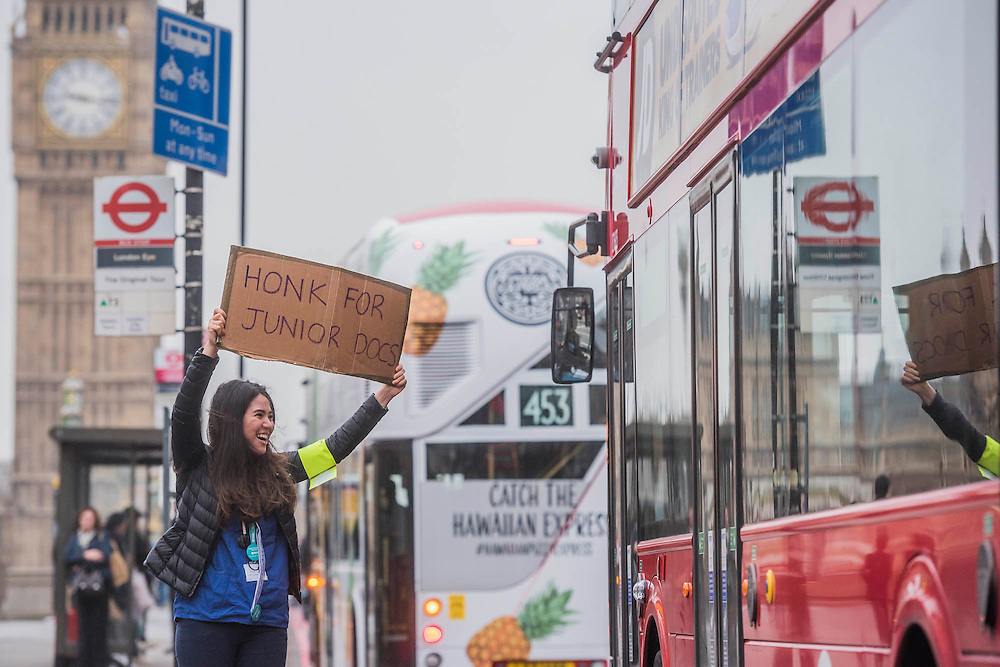 Dr Anjani Knobel gets support from passing traffic  - The picket line at St Thomas' Hospital. Junior Doctors stage another 48 hours of strike action against the new contracts due to be imposed by the Governemnt and health minister Jeremy Hunt.