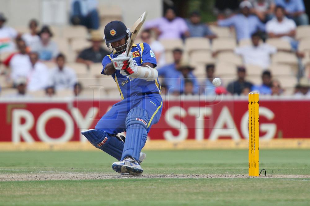 © Licensed to London News Pictures. 14/02/2012. Adelaide Oval, Australia. Nuwan Kulasekara attempts to hit the ball behind him during the One Day International cricket match between India Vs Sri Lanka. Photo credit : Asanka Brendon Ratnayake/LNP