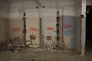 Stay spray painted onto walls destined to remain in the redevelopment of Birmingham, United Kingdom.