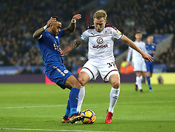 Leicester City's Danny Simpson (left) and Burnley's Scott Arfield battle for the ball